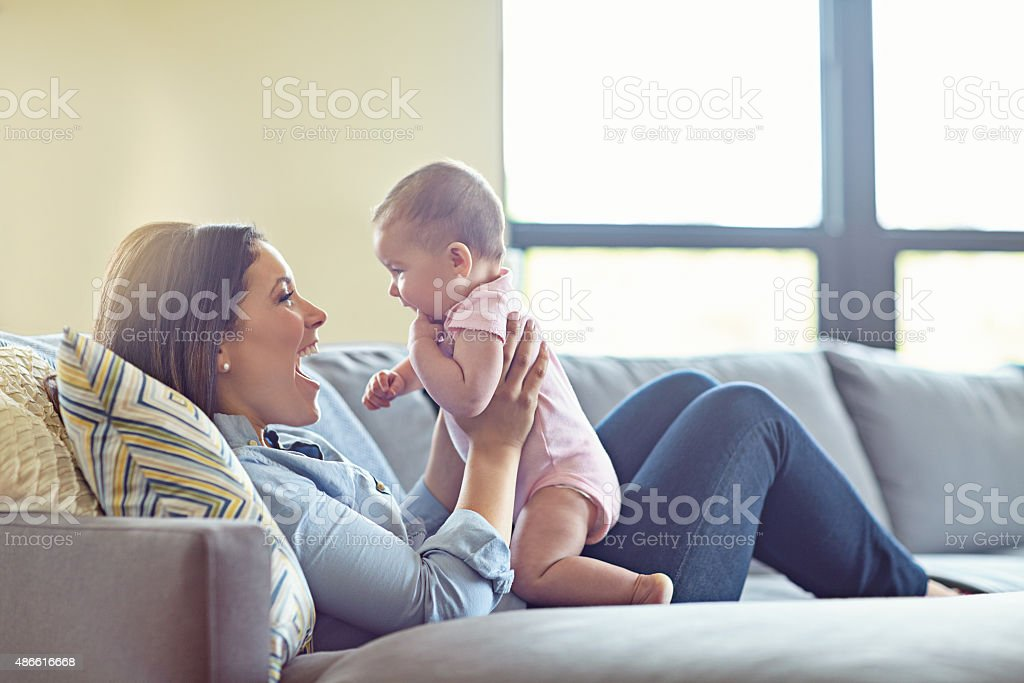 Sofa surfing with mommy stock photo