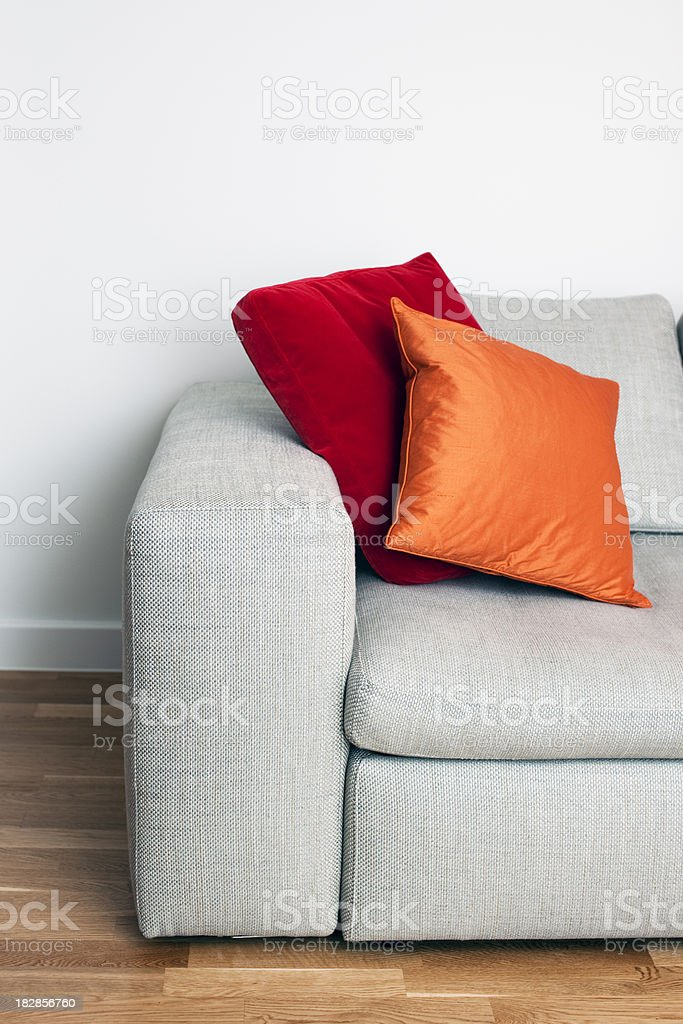 Sofa with bright coloured cushions royalty-free stock photo