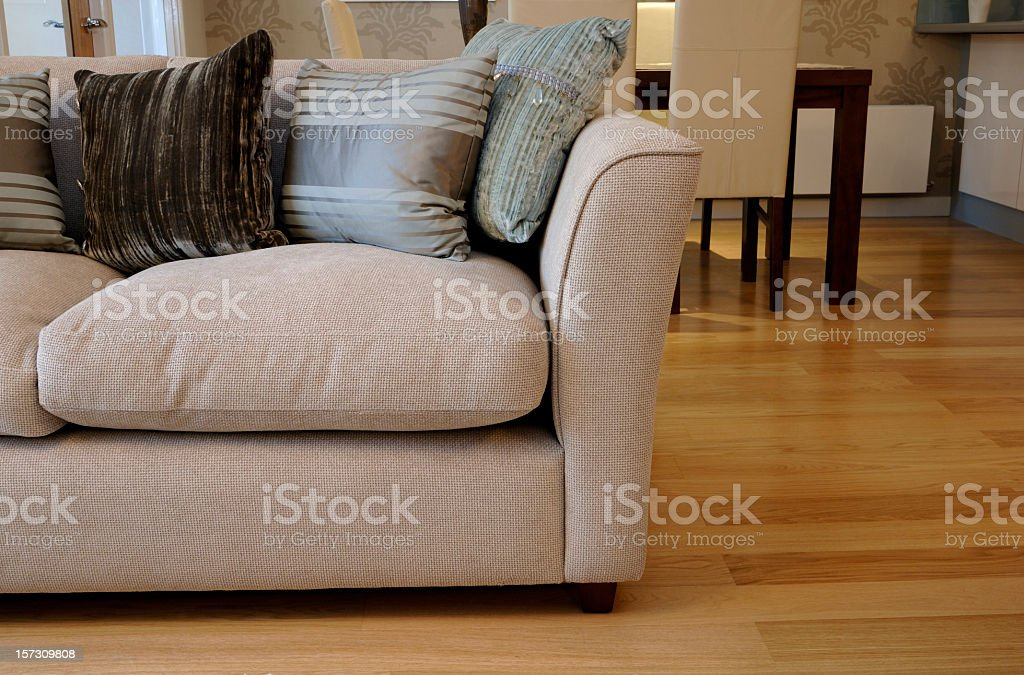 Sofa with cushions in modern apartment stock photo