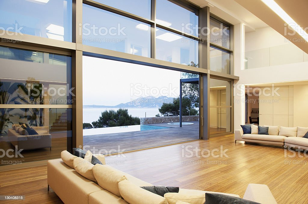 Sofas and sliding doors in open modern house stock photo