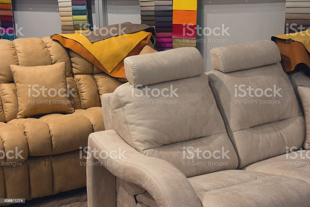 Sofas and upholstery samples in the exhibition hall. Sale stock photo