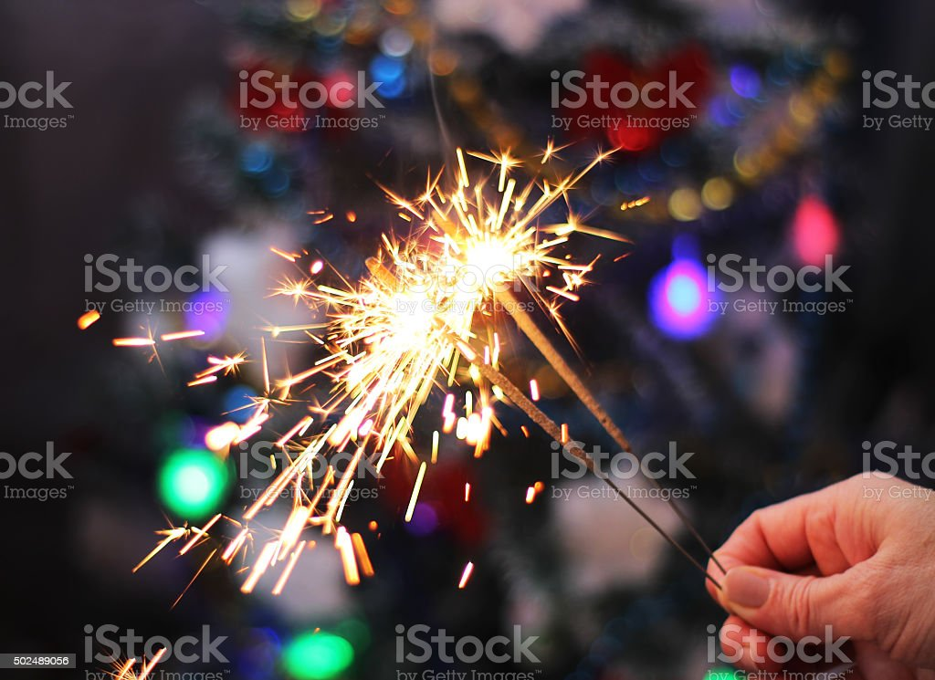 Soft and blur conception.Female hand holding a burning sparklers stock photo