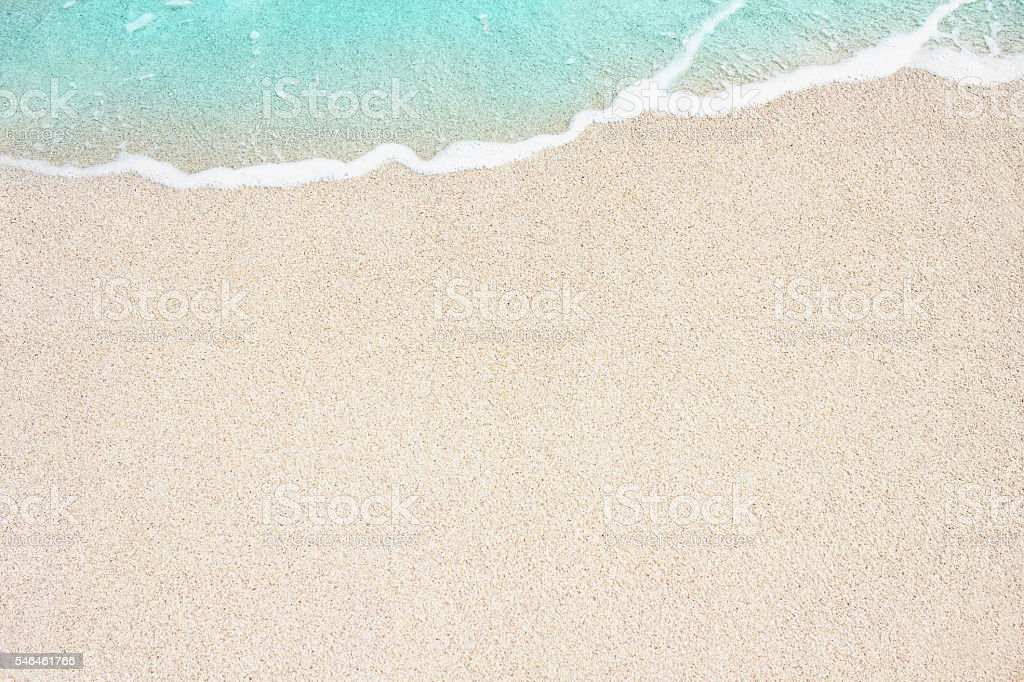 Soft blue ocean wave on sandy beach stock photo