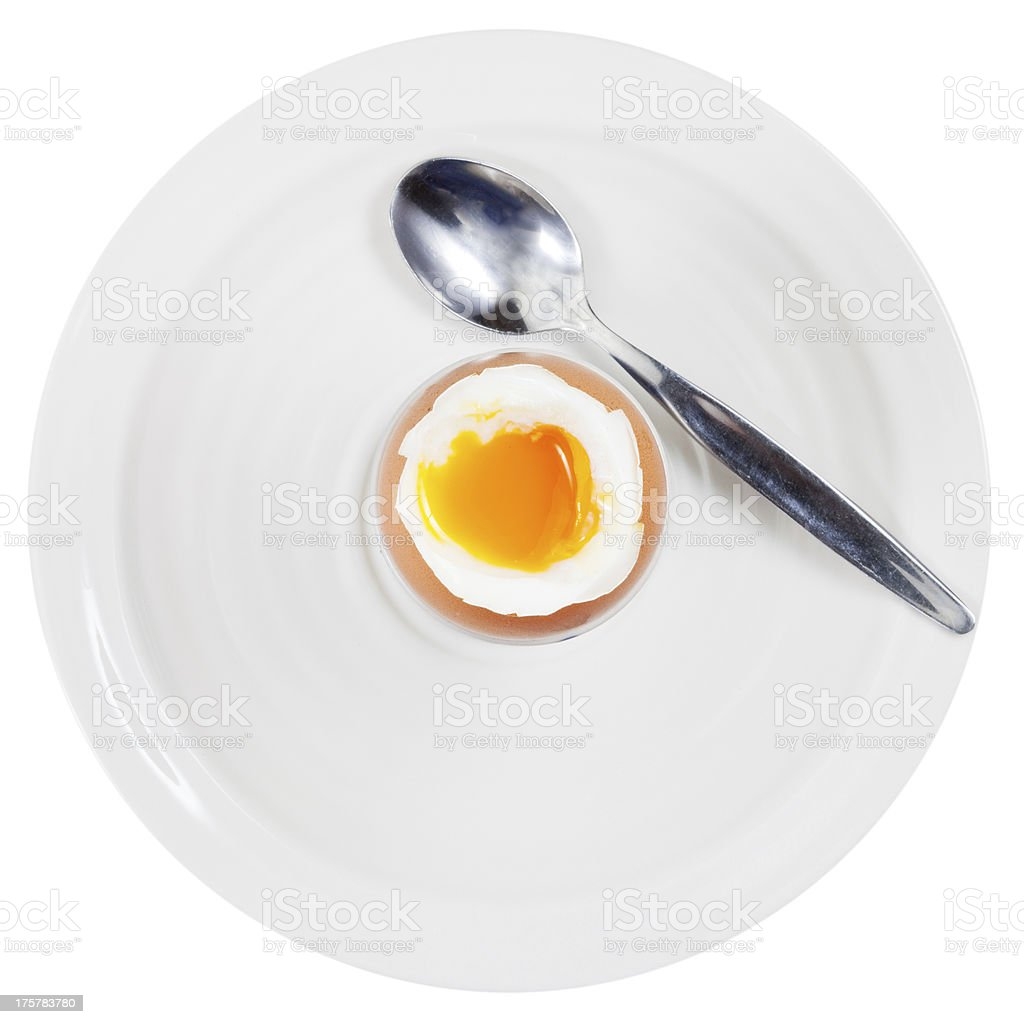 soft boiled egg in cup on white plate stock photo