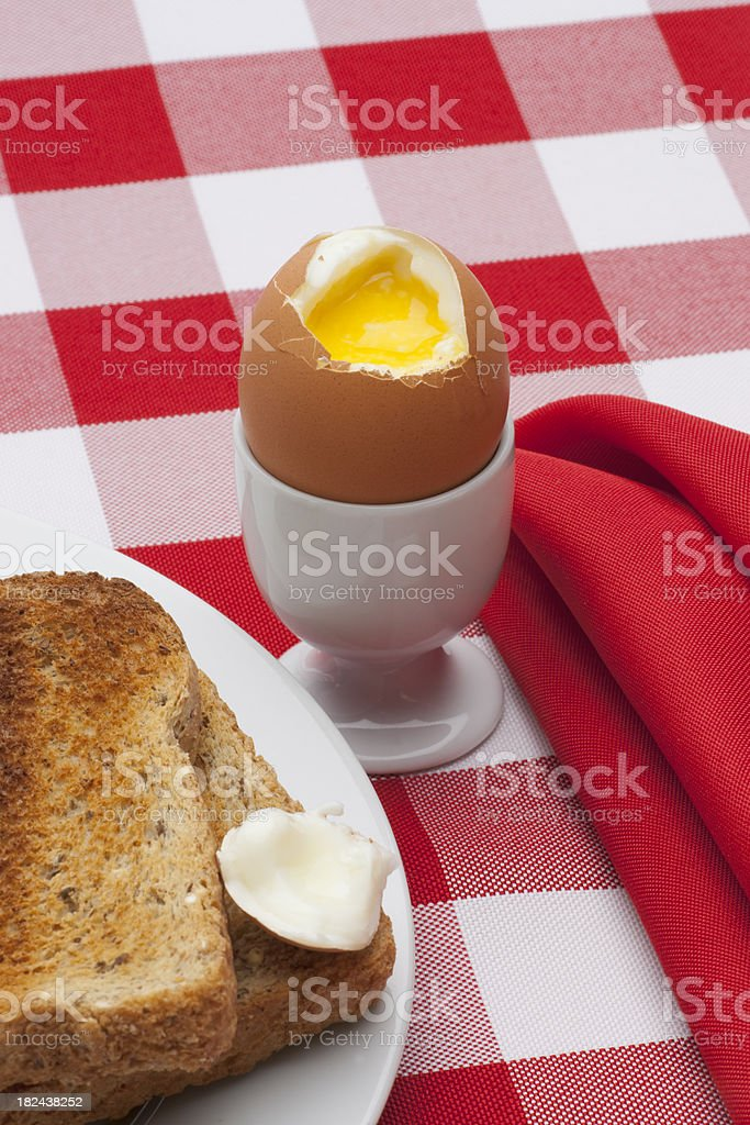 Soft Boiled Egg, Toast on Table Cloth Vertical stock photo
