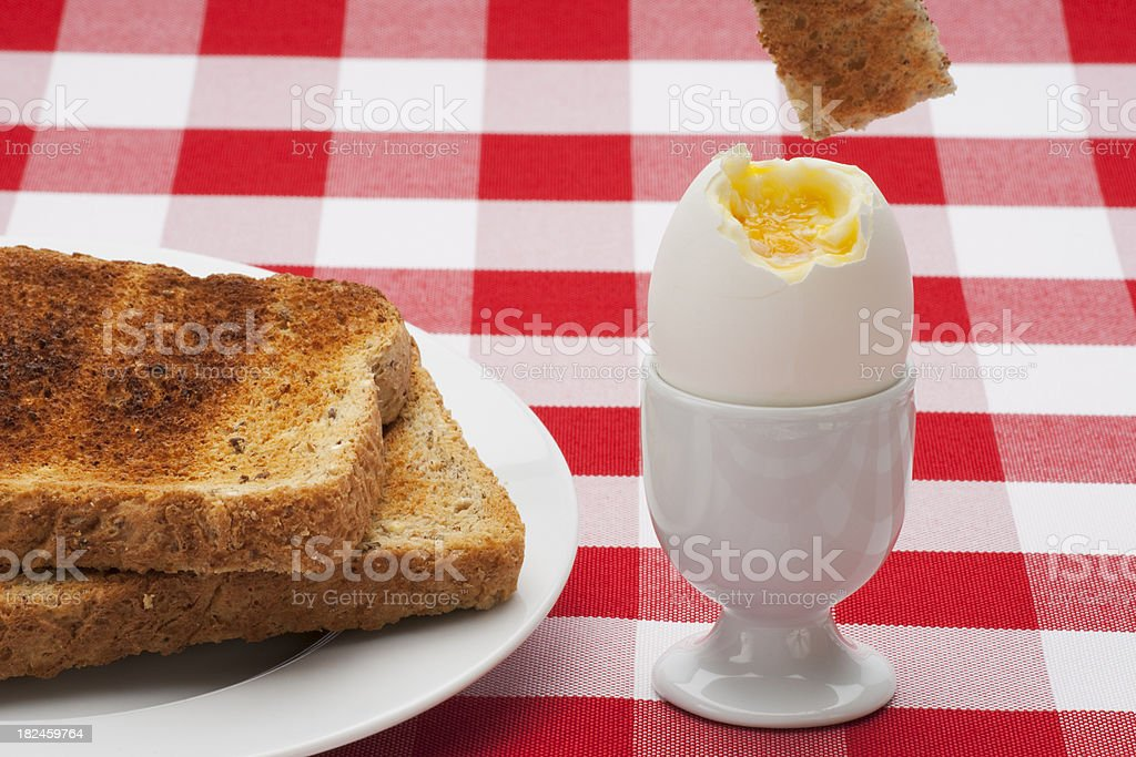 Soft Boiled Egg, Toast Soldier on Table Cloth Vertical stock photo