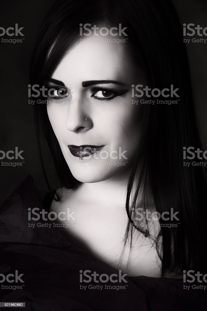Soft B&W portriat of woman with pained smile. stock photo