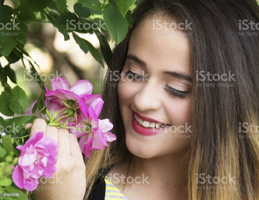 Soft colour portrait of 15 year old girl with roses. stock photo