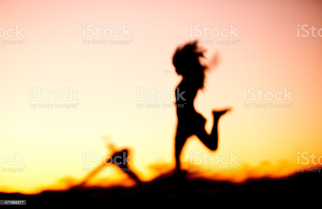 Soft dreamy image of woman running at sunset stock photo