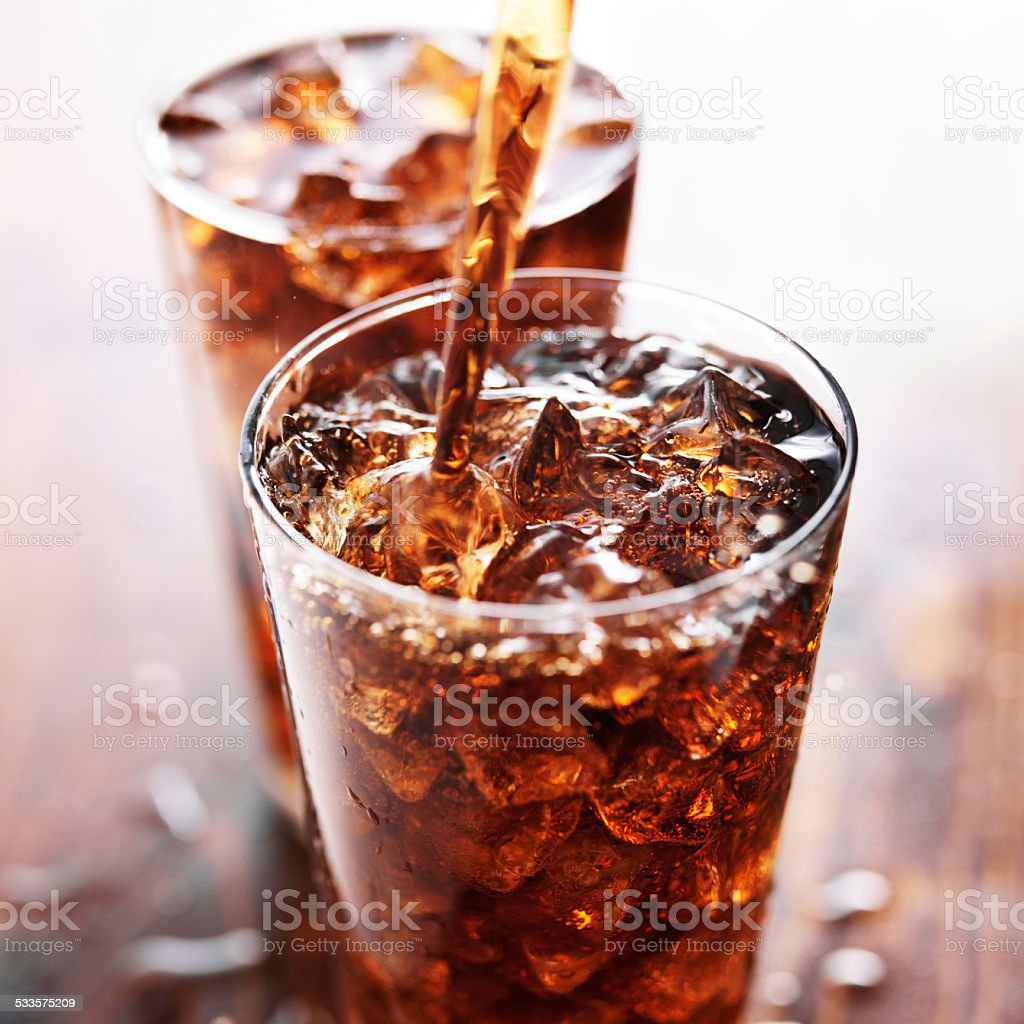 soft drink being poured into glass royalty-free stock photo