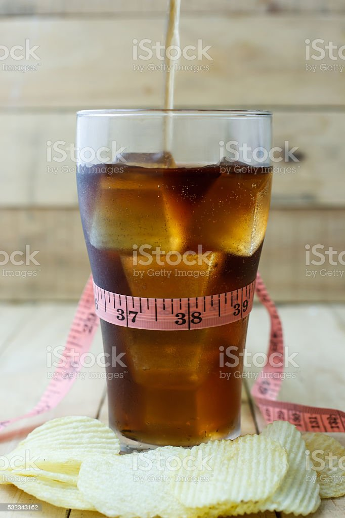 Soft drink in glass on wood background, Selection focus stock photo
