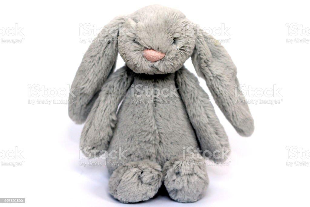 A soft fluffy grey rabbit toy stock photo