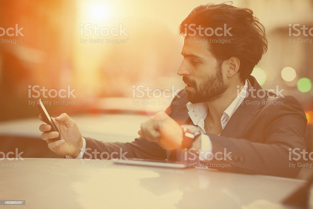 Soft focus of a young handsome man texting royalty-free stock photo