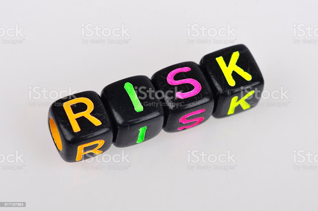 Soft Focus of 'RISK' Word on Colorful Dices stock photo
