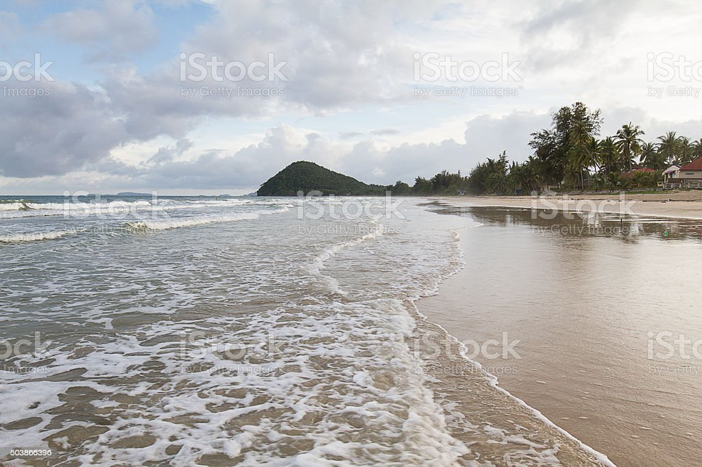 Soft focus of wave on the seashore against cloudy  sky stock photo