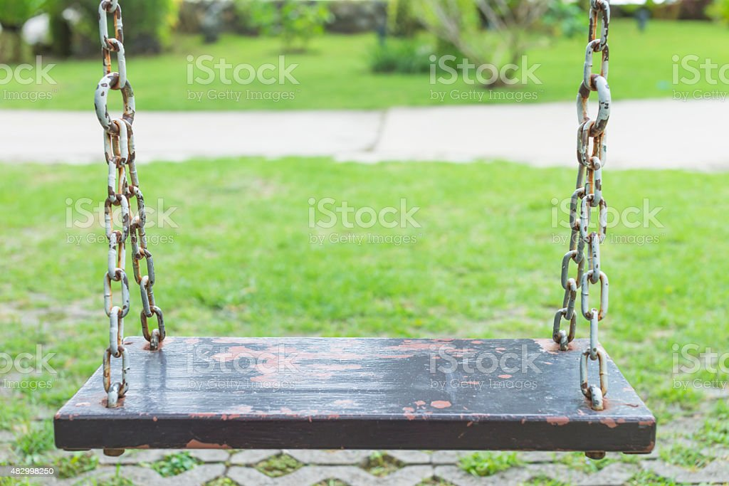 Soft focus on swing in garden royalty-free stock photo