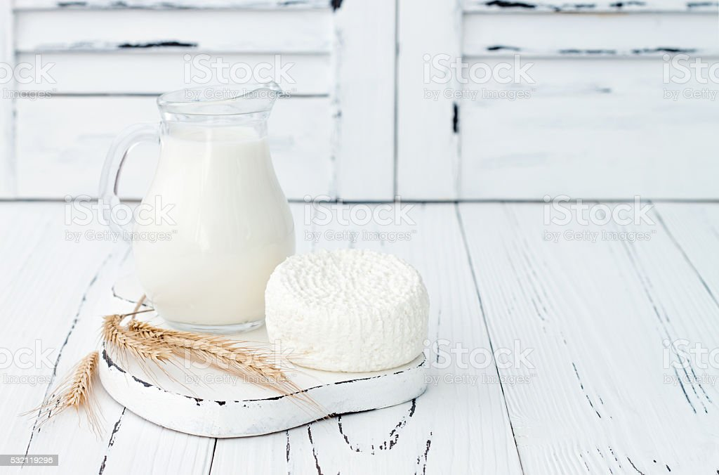 Soft homemade ricotta cottage Tzfat cheese. Judaic holiday Shavuot symbols. stock photo