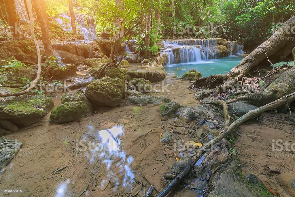 soft light with waterfall in a deep forest stock photo
