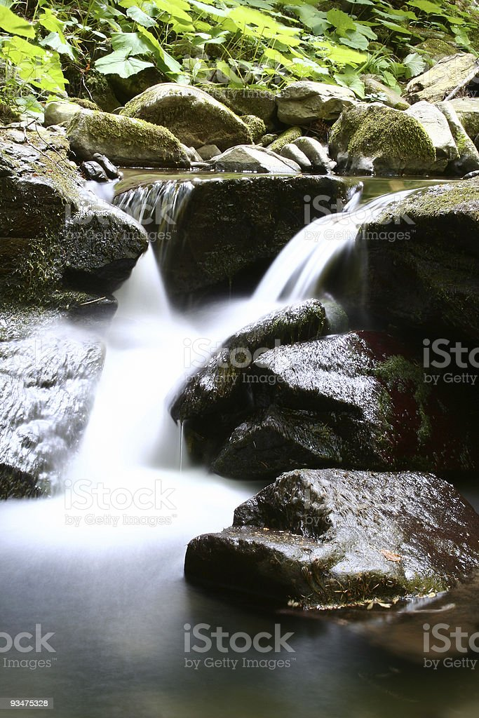Soft little peaceful waterfall close up royalty-free stock photo