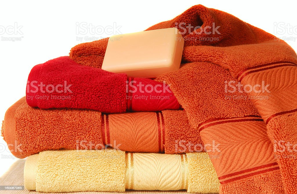 Soft luxurious towels with a bar of soap royalty-free stock photo