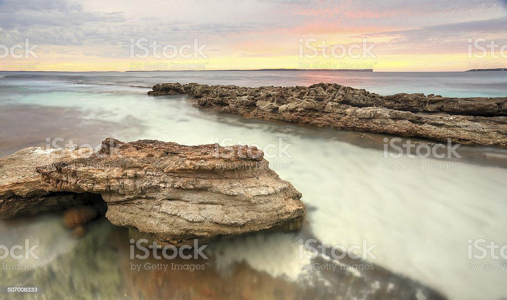 Soft pastel colours of a sunrise at Hyams Beach Australia stock photo