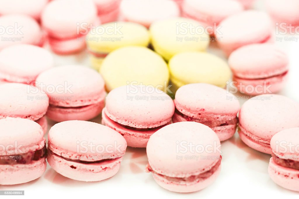 Soft Pink and Yellow Macaroons on White stock photo
