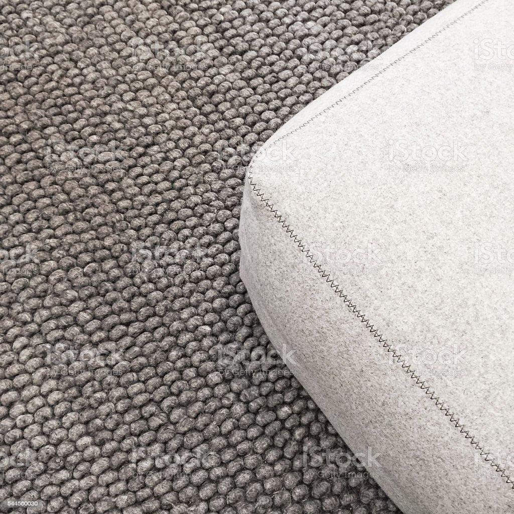 Soft seat on gray carpet stock photo