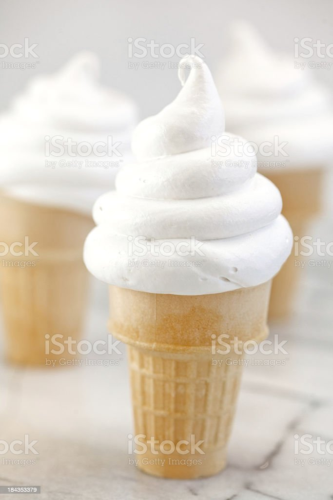 Soft serve vanilla ice cream cones stock photo