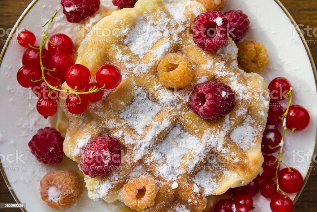 soft waffles with fresh berries stock photo