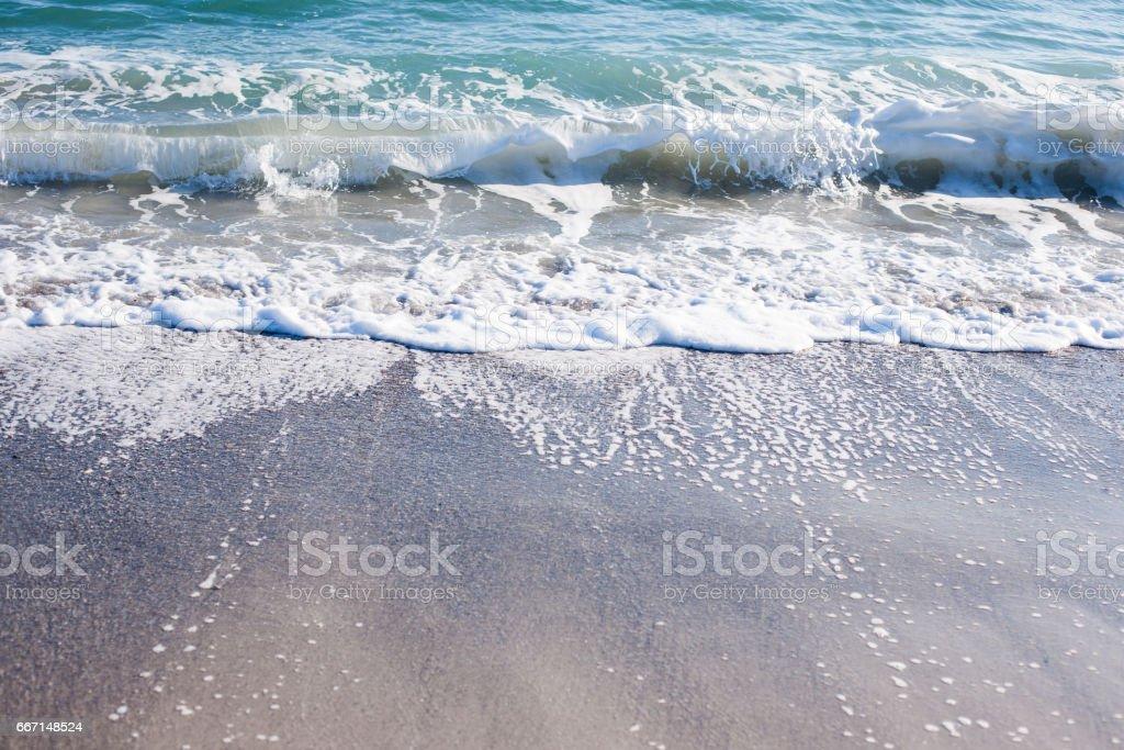 Soft wave of Black sea on sandy beach stock photo
