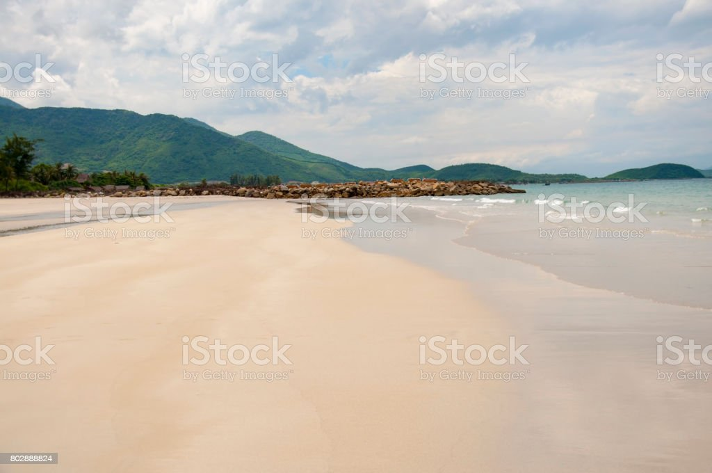 Soft wave of blue ocean on a sandy beach. With the blur. stock photo