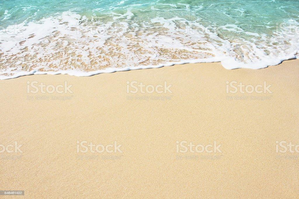 Soft wave of blue ocean on sandy beach. stock photo