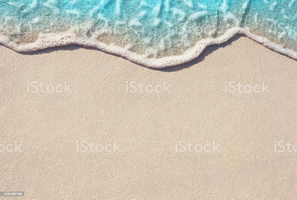 Soft wave of ocean on sandy beach stock photo
