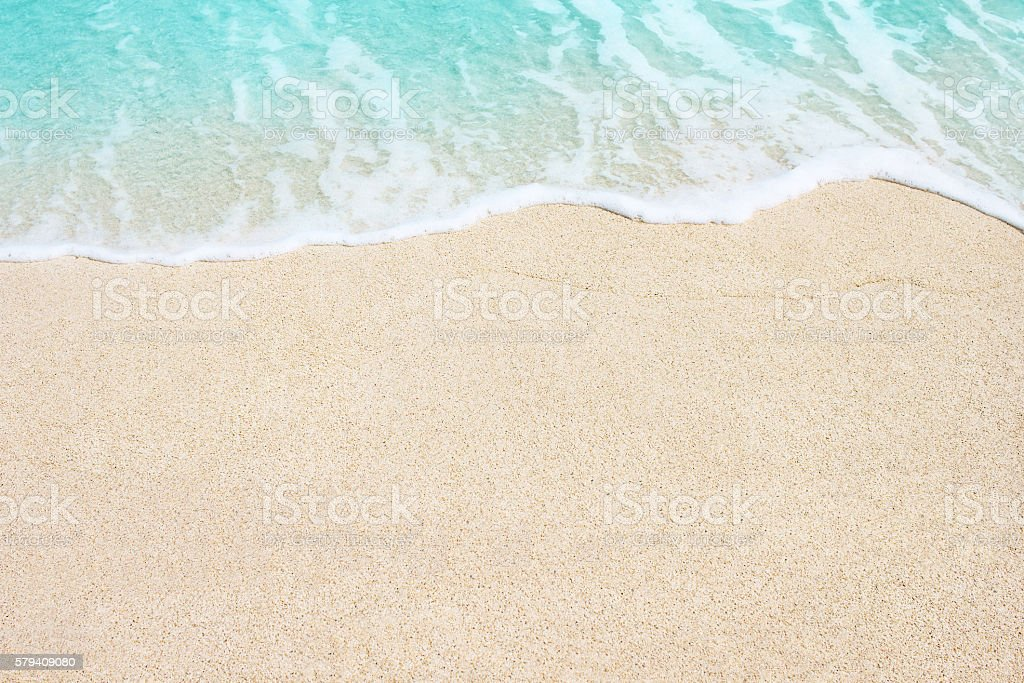 Soft wave of ocean on the sandy beach stock photo