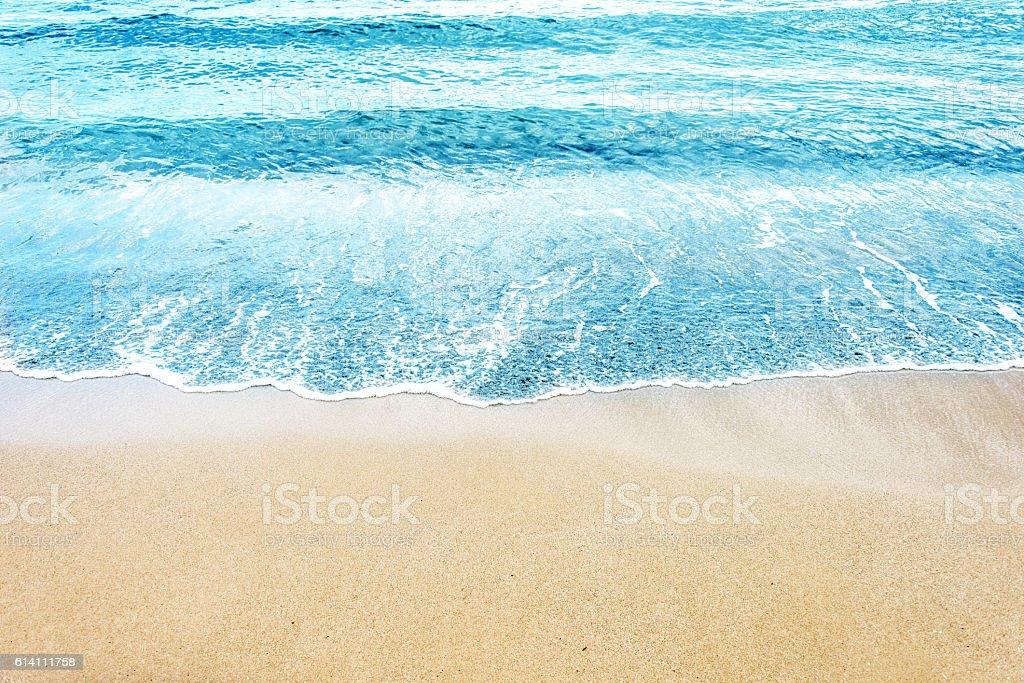 soft wave of ocean on the sandy beach stock photo