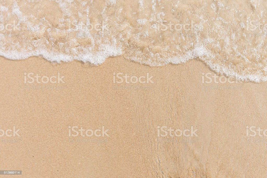 Soft wave of sea on beach with foam. Copy space stock photo