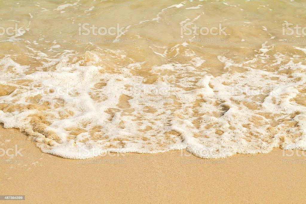 Soft wave of the sea on the sandy beach stock photo