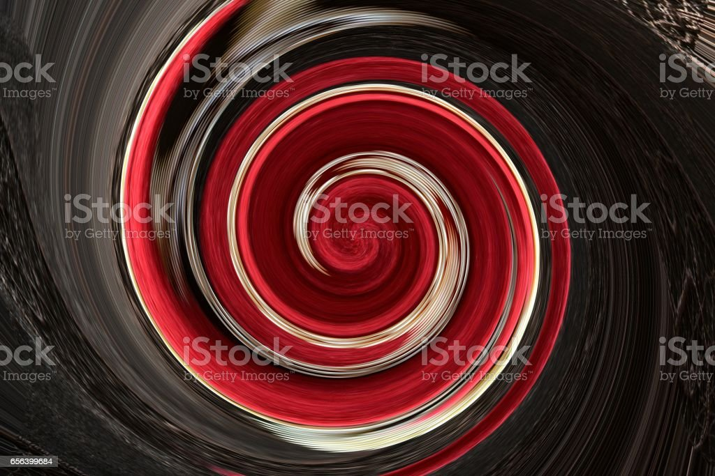 Soft wool of chocolate color is twisted into a spiral stock photo