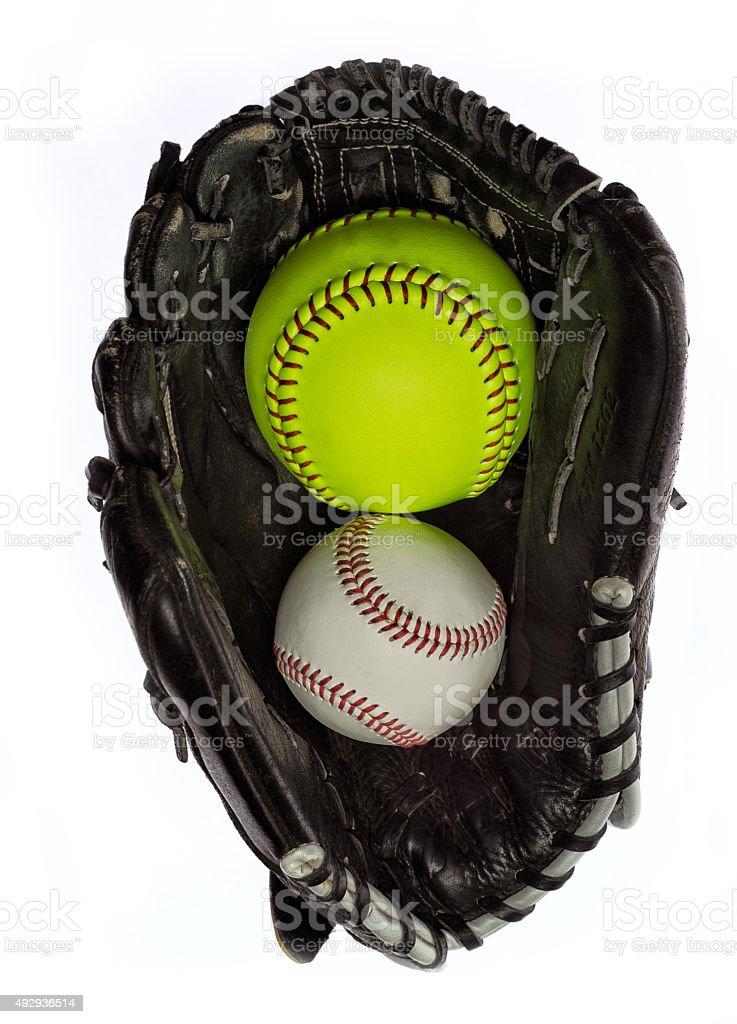 Softball and baseball in a glove stock photo