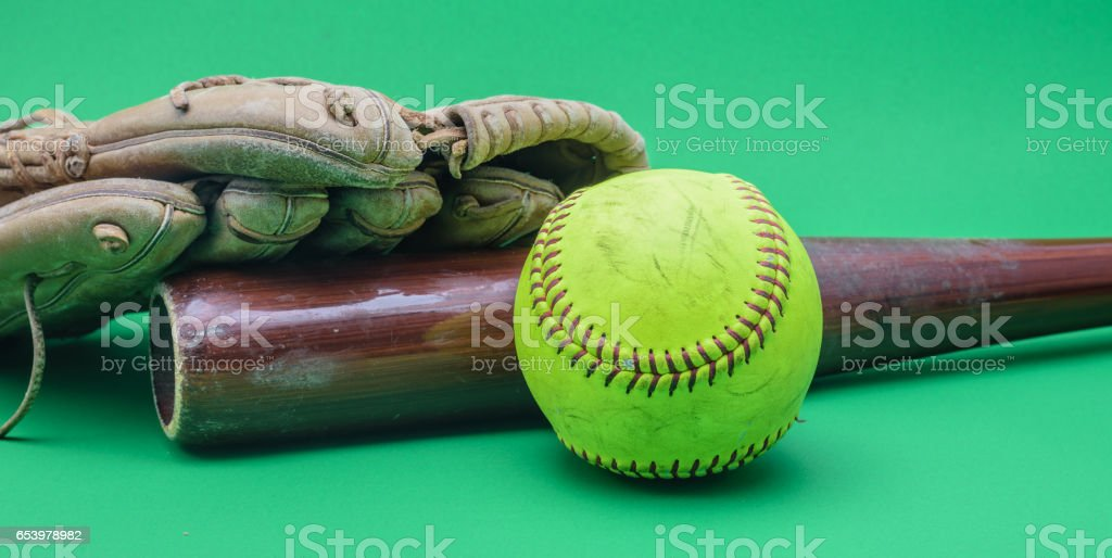 Softball, bat and leather glove stock photo