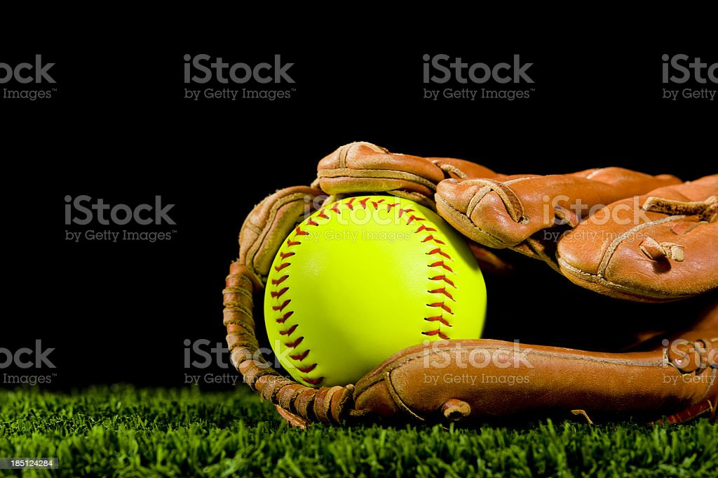 Softball in Grass at Night royalty-free stock photo