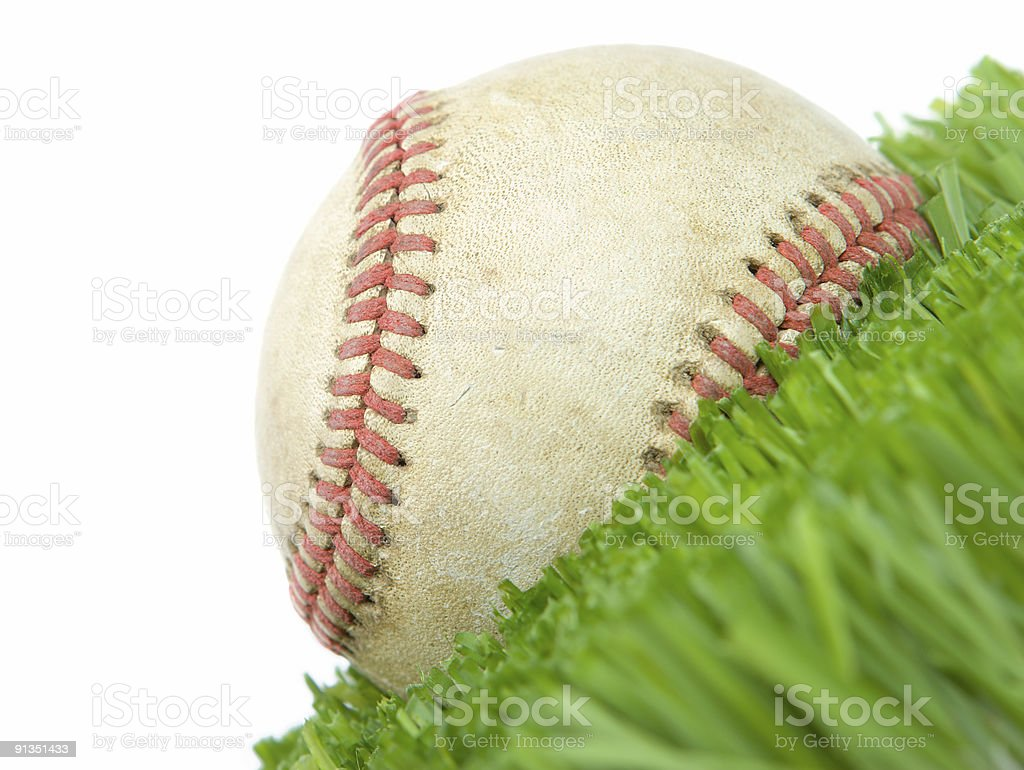 Softball in grass close up royalty-free stock photo