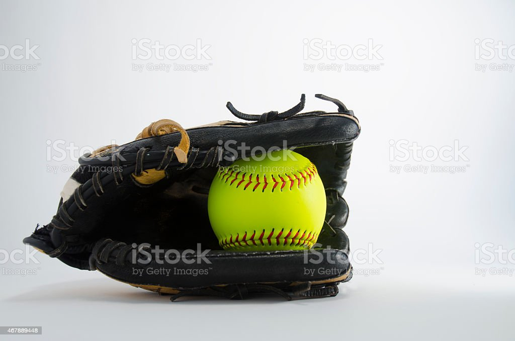 Softball and glove.