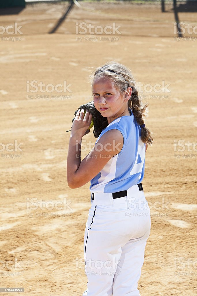Girl on mound. Image shot from second base position looking in toward...