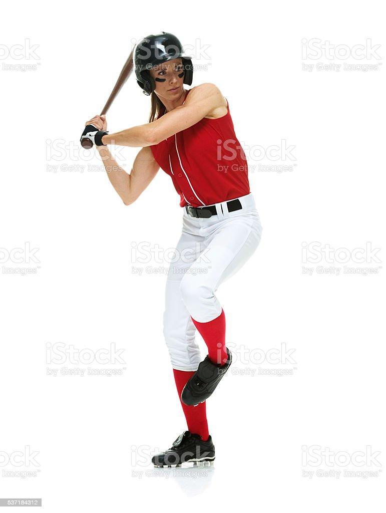 Softball player batting stock photo
