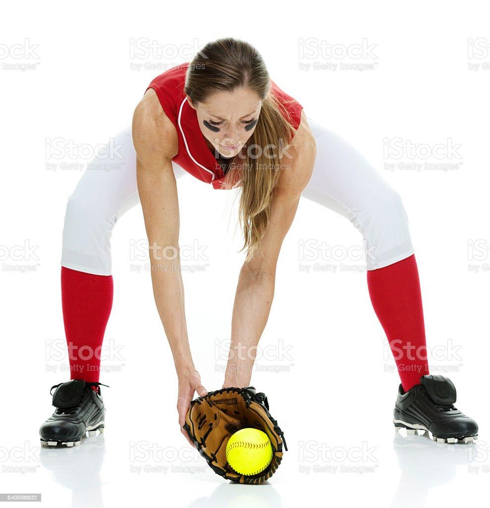 Softball player catching ball stock photo