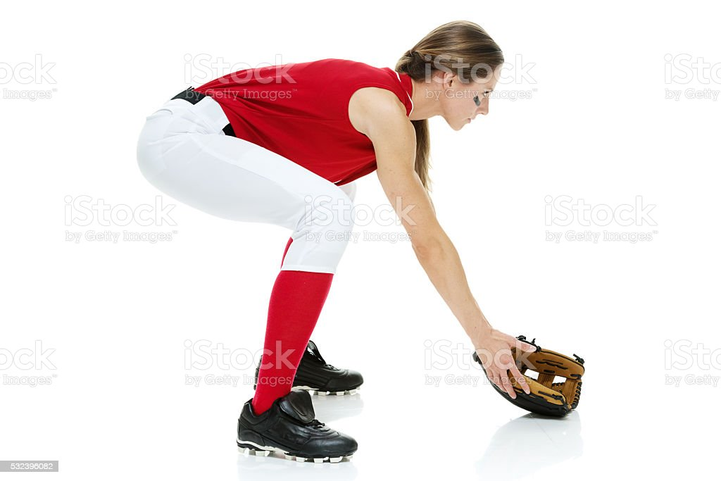 Softball player fielding stock photo