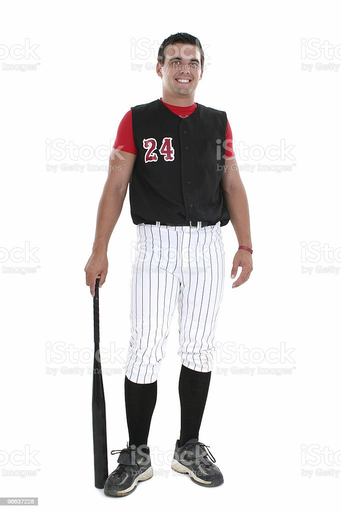 Softball Player in Uniform with Bat stock photo