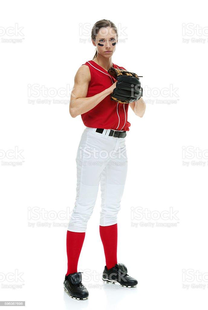 Softball player looking at camera stock photo