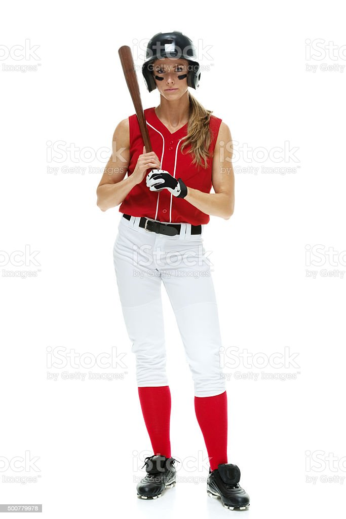 Softball player standing and holding bat stock photo